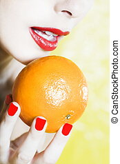 Beautiful Woman Portrait Showing a orange tangerine fruit