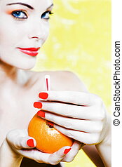 Beautiful Woman Portrait offering orange juice - beautiful...