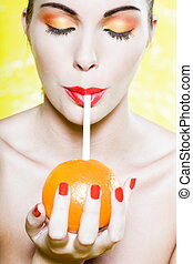 Beautiful Woman Portrait orange drink - beautiful caucasian...