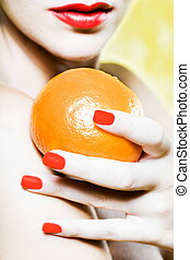 Woman Portrait holding a mandarin orange tangerine -...