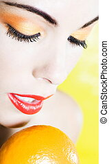 Beautiful Woman Portrait holding a mandarin - beautiful...