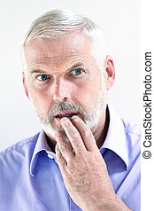 Senior man portrait stun pensive - caucasian senior man...