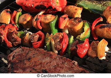 Barbecue shish kabob and steak - Barbecuing shish kabobs...