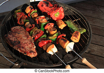 Barbecue shish kabob and steak - Barbecuing shish kabobs...