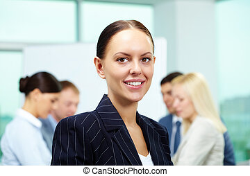 Pretty leader - Portrait of smart employer looking at camera...