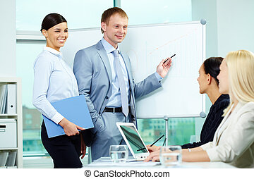 Seminar - A business man explaining something on a...