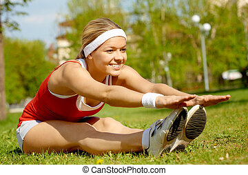 Outdoor fitness - Portrait of a young woman doing physical...