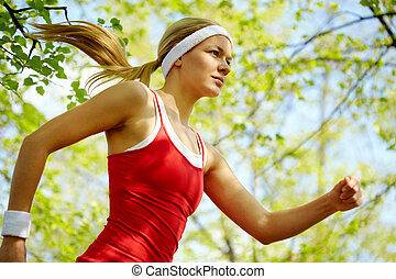 Sports girl  - Portrait of a young woman jogging