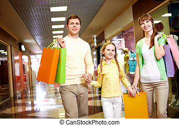 Shopping time - Image of family spending their time in the...