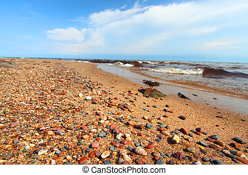 Lake Superior Beach in Michigan - Smoothed stones along the...