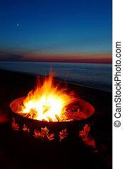 Lake Superior Beach Campfire - Campfire burns brightly at...