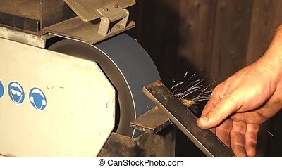 Grinding - grinding a piece of metal