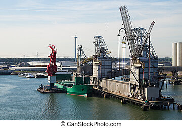 Ship getting loaded with grain at terminal - grain elevator...