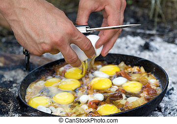 Fried eggs. Cooking on the fire.