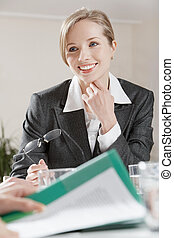 Attention - Portrait of businesswoman listening to her...