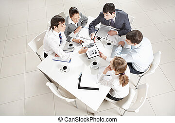 Business education - Above view of business team sitting...