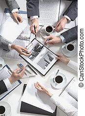 Working together - Image of hands of working businesspeople...