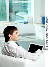 Office worker - Image of young successful businessman...