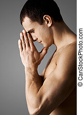 Prayer - Image of calm guy keeping his palms by face