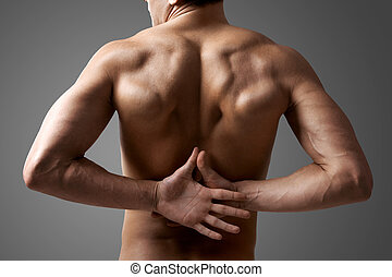 Male back - Back view of handsome man with hands behind
