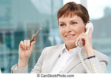 Calling - Photo of smart businesswoman calling and smiling