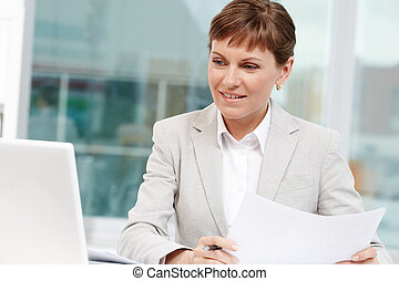 Working in office - Photo of smart businesswoman working in...