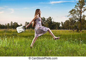Stylish woman in dress with bag outdoor. Summer shopping...