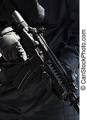 Soldier with automatic rifle - Closeup of an automatic rifle