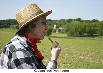 farmer and corn cob pipe