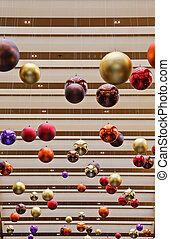 Colorful Christmas Decorations Hanging From Ceiling