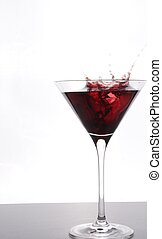 Cocktail party - Red cocktail with a big splash, copy space...