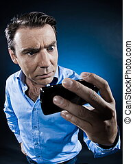 Man Portrait Frown with cellphone - caucasian man looking at...