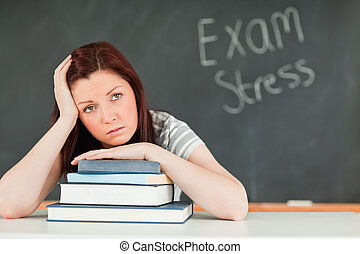 Beautiful student stressed by her examinations in a...