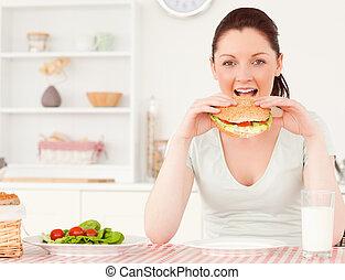 Cute woman eating a sandwich