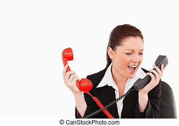 Cute secretary driven crazy by the phone calls against a...
