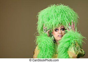 Serious Drag Queen - Serious drag queen holds wig on green...