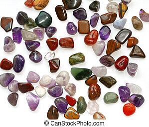 Semiprecious stones on white background - Colorful...