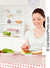 Cute woman ready to eat a sandwich for lunch
