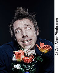 Funny Man Portrait offering flowers stressed - studio...