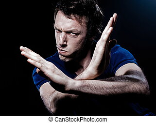 Funny Man Portrait anger refuse gesture - studio portrait on...