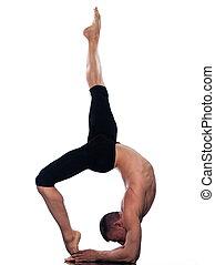 Man yoga Eka Pada Viparita Dandasana pose - caucasian man...