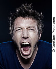 Funny Man Portrait screaming - studio portrait on black...