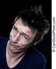 Funny Man Portrait - studio portrait on black background of...