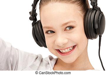 happy teenage girl in big headphones - picture of happy...