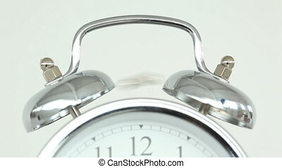 Clock ringing against a white background