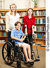 Kids in Library - Disabilities - Group of teens in the...