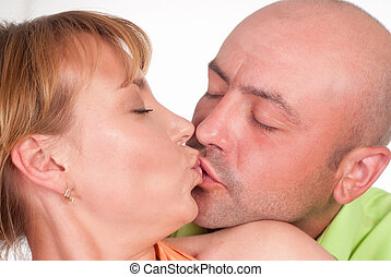 couple kissing on whte - beautiful couple in color clothes...