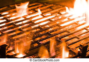 Charcoal grill - Closeup of charcoal burning under a...