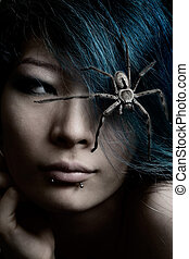 Portrait of model with spider in hair