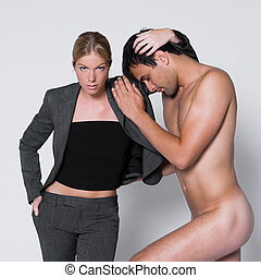 woman seductress with man naked in studio on isolated grey...